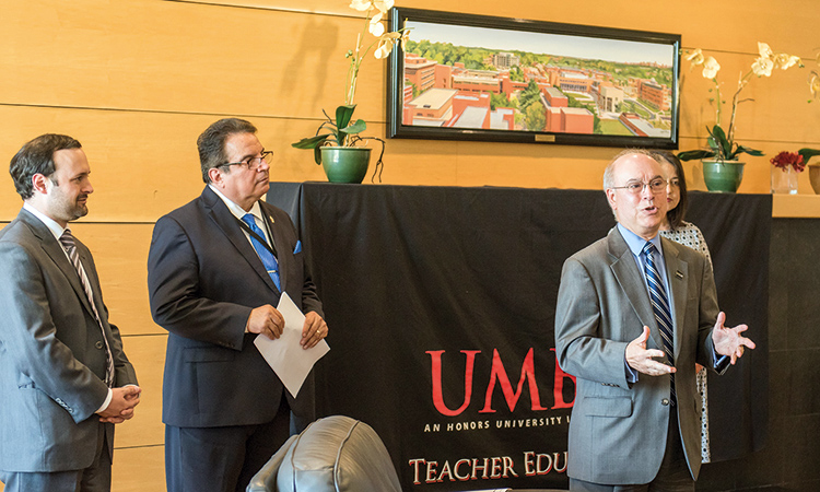 Dr. Antonio Moreira (right) hosting an international event at UMBC